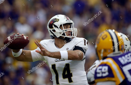 Pete Thomas Louisiana-Monroe quarterback Pete Thomas (14) passes under pressure in the first half of an NCAA college football game against LSU in Baton Rouge, La