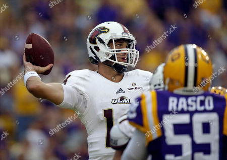 Pete Thomas Louisiana Monroe quarterback Pete Thomas (14) passes under pressure in the first half of an NCAA college football game against LSU in Baton Rouge, La