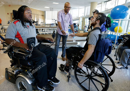 Eric LeGrand, Adam Taliaferro, Jonathan Ulassin Eric LeGrand, left, alumni of Rutgers University and Adam Taliaferro, center, alumni of Penn State University, college football players who suffered serious spinal cord injuries on the field, talk with Jonathan Ulassin, 19, while visiting children at PSE&G Children's Specialized Hospital, in New Brunswick, N.J. LeGrand and Taliaferro will be the honorary captains when Rutgers and Penn State meet Saturday at High Point Solutions Stadium in the Big Ten Conference opener