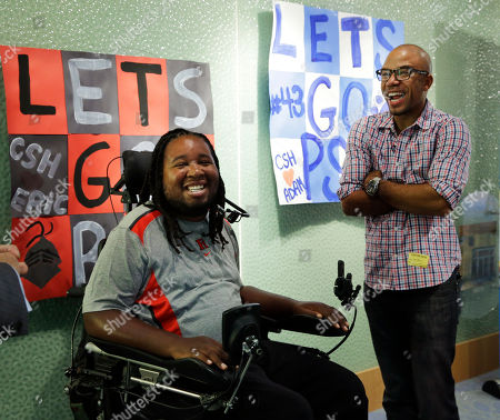 Eric LeGrand, Adam Taliaferro Eric LeGrand, left, alumni of Rutgers University and Adam Taliaferro alumni of Penn State University, college football players who suffered serious spinal cord injuries on the field, laugh as they stand near posters before visiting children at PSE&G Children's Specialized Hospital, in New Brunswick, N.J. LeGrand and Taliaferro will be the honorary captains when Rutgers and Penn State meet Saturday at High Point Solutions Stadium in the Big Ten Conference opener