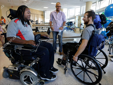 Eric LeGrand, Adam Taliaferro, Jonathan Ulassin Eric LeGrand, left, alumni of Rutgers University and Adam Taliaferro, center, alumni of Penn State University, college football players who suffered serious spinal cord injuries on the field, talk with Jonathan Ulassin, 19, while visiting children at PSE&G Children's Specialized Hospital., in New Brunswick, N.J. LeGrand and Taliaferro will be the honorary captains when Rutgers and Penn State meet Saturday at High Point Solutions Stadium in the Big Ten Conference opener