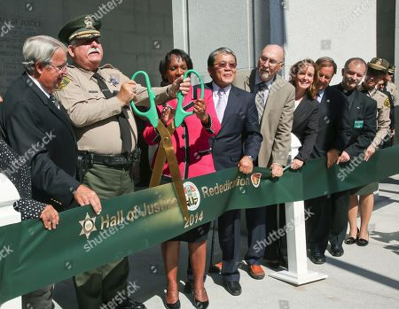 Don Knabe, John Scott, Jackie Lacey, William Fujioka, Gail Farber Los Angeles County Sheriff John Scott, second from left, and District Attorney Jackie Lacey, third from left, cut a ribbon with members of the Los Angeles County Board of Supervisors, chairman Don Knabe, far left, Sheriff's Department officer William Fujioka, fourth from left, and Department of Public Works Director Gail Farber, six from left, and other unidentified officials during a ceremony marking the reopening of the Los Angeles Hall of Justice, in Los Angeles, after a two-decade closure and a $231 million renovation. The ornate neoclassical building was built in 1925