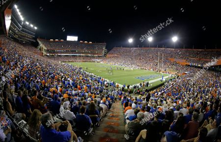 Fans watch an NCAA college football game at Ben Hill Griffin Stadium at Florida Field between Florida and LSU in Gainesville, Fla