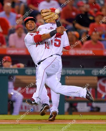 Luis Jimenez Los Angeles Angels third baseman Luis Jimenez attempts to throw out Seattle Mariners' Chris Taylor at first during the sixth inning of a baseball game, in Anaheim, Calif. Taylor was safe at first on the play