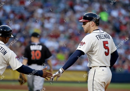 Freddie Freeman, Terry Pendleton Atlanta Braves' Freddie Freeman, right, high-fives first base coach Terry Pendleton after hitting a single in the seventh inning of a baseball game against the Miami Marlins, in Atlanta