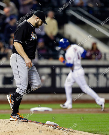 Brad Penny Miami Marlins starting pitcher Brad Penny (33) reacts as New York Mets' Wilmer Flores (4) runs the bases after hitting a two run home run during the seventh inning of a baseball game, in New York