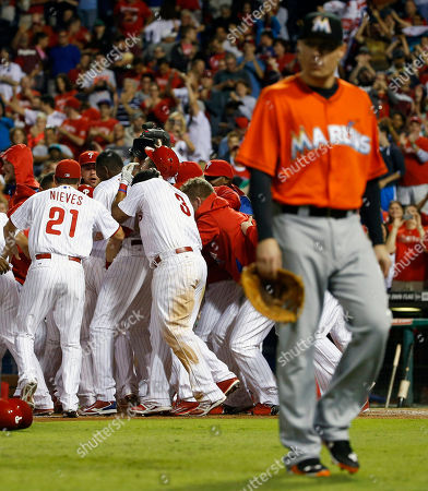 Jeff Baker Philadelphia Phillies players celebrate after Cody Asche's game-winning two-run home run as Miami Marlins first baseman Jeff Baker, right, walks off the field during the 10th inning of a baseball game, in Philadelphia. Philadelphia won 3-1 in 10 innings