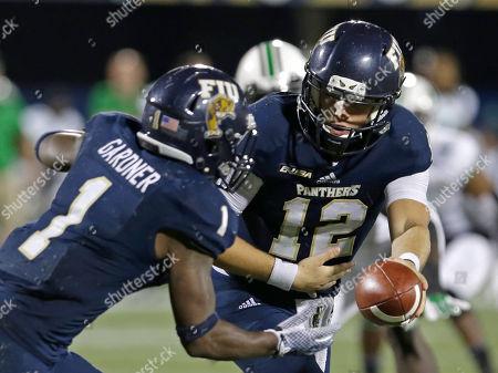 Alex McGough, Alex Gardner Florida International quarterback Alex McGough (12) hands over to running back Alex Gardner (1) against Marshall during the second half of an NCAA college football game, in Miami