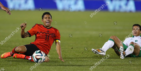 Jose Luis Chavez, Javier Aquino Mexico midfielder Javier Aquino, left, reacts after being tripped up while driving for a shot by Bolivia midfielder Jose Luis Chavez in the first half of an international friendly soccer game in Commerce City, Colo., on