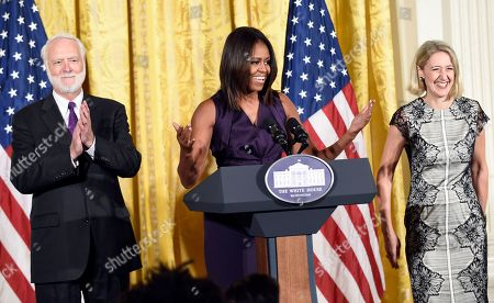 Michelle Obama, Wayne Clough, Caroline Baumann First lady Michelle Obama speaks at a luncheon in the East Room of the White House in Washington, to honor of the winners of the 2014 National Design Awards, which are organized by the Smithsonian's Cooper-Hewitt, National Design Museum. Mrs. Obama is flanked by Wayne Clough, secretary of the Smithsonian Institution, left, and Caroline Baumann, director of Cooper Hewitt Design Museum, right