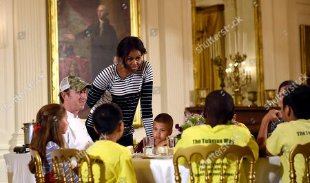 Michelle Obama, Geoff Tracy First lady Michelle Obama talks with school children as they eat lunch in the East Room of the White House following the annual fall harvest of the White House Kitchen Garden in Washington, . Chef Geoff Tracy second from left, sits at the table. In celebration of Farm to School Month, the Obama invited students from Arizona, California, and Ohio to participate in the fall harvest. These schools were selected because they are participating in farm to school programs that incorporate fresh, local food into their school meals, and they teach students about healthy eating through school gardens and nutrition education