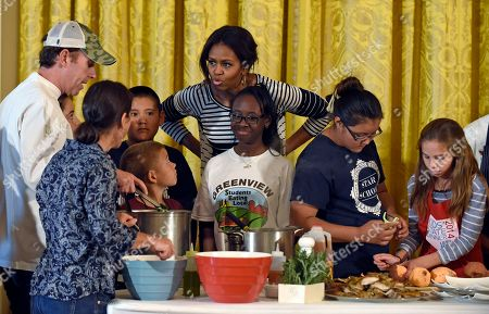 Michelle Obama, Geoff Tracy First lady Michelle Obama talks with school children as prepare lunch in the East Room of the White House following the annual fall harvest of the White House Kitchen Garden in Washington, . Chef Geoff Tracy, left, worked with the children. In celebration of Farm to School Month, the Obama invited students from Arizona, California, and Ohio to participate in the fall harvest. These schools were selected because they are participating in farm to school programs that incorporate fresh, local food into their school meals, and they teach students about healthy eating through school gardens and nutrition education
