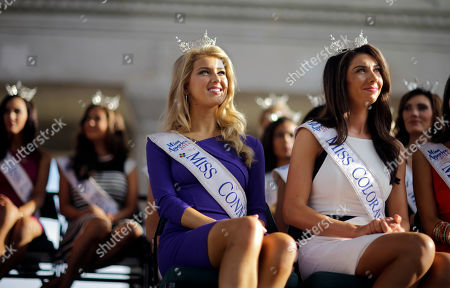 Acacia Courtney, Stacey Cookwatch Miss America Pageant contestants Miss Connecticut Acacia Courtney, foreground left, and Miss Colorado Stacey Cookwatch, right, attend arrival ceremonies, in Atlantic City, N.J. Miss America contestants from all 50 states, the District of Columbia, Puerto Rico and the U.S. Virgin Islands will appear to the public Wednesday afternoon at the traditional welcoming ceremony across from Boardwalk Hall