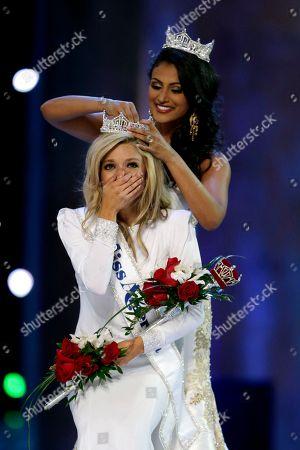 Nina Davuluri, Kira Kazantsev Miss America 2014 Nina Davuluri, top, crowns Miss New York Kira Kazantsev as Miss America 2015, in Atlantic City, N.J