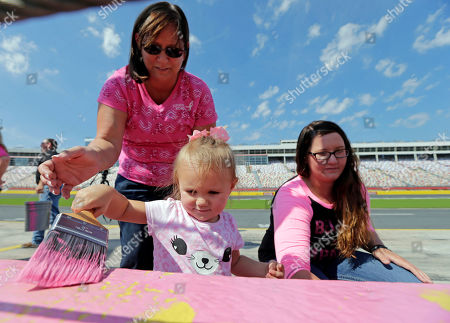 Ryann Morgan, Alethea Morgan, Brittany Morgan Ryann Morgan, 2, center, helps her grandmother, Alethea Morgan, left, and aunt Brittany Morgan, right, paint the pit road wall pink at Charlotte Motor Speedway to honor National Breast Cancer Awareness Month in Concord, N.C., . Alethea Morgan is a 5 year breast cancer survivor