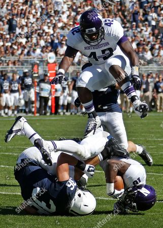 Deron Thompson, Joseph Jones, Godwin Igwebuike Penn State's Deron Thompson (36) fumbles on a punt after being hit by Northwestern safety Godwin Igwebuike (16), who recovers the ball, as Joseph Jones (42) leaps over them during the fourth quarter of an NCAA college football game in State College, Pa., . Northwestern was penalized on the play. Northwestern won 29-6