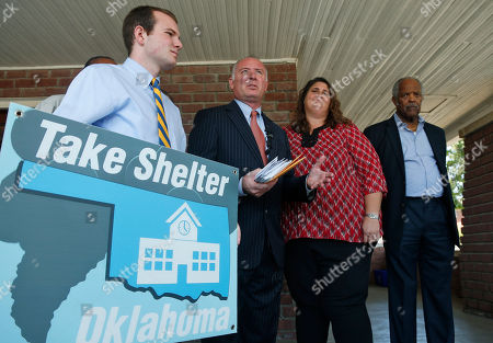 Logan Slane, David Slane, Danni Legg, John A. Reed Logan Slane, left, a senior at South Moore High School, holds a Take Shelter Oklahoma sign during a news conference held by supporters of an initiative petition to place storm shelters in every Oklahoma public school, in Oklahoma City, . From left are Logan Slane, his father, Oklahoma City attorney David Slane, who represents the organization, Danni Legg, the mother of tornado victim Christopher Legg, and Pastor John A. Reed Jr