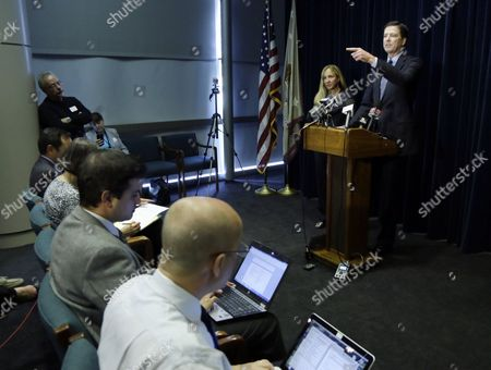 James B. Comey, Amanda Marshall FBI Director James B. Comey, right, gestures as U.S. Attorney Amanda Marshall stands at left during a news conference in Portland, Ore., . Comey spoke after the sentencing in federal court of Mohamed Mohamud, who was convicted last year of a terrorism charge