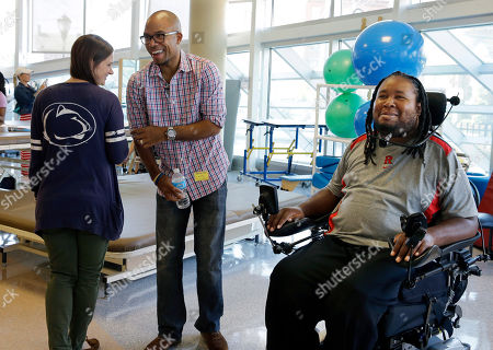 Eric LeGrand, Adam Taliaferro, Tara Mohamed Eric LeGrand, right, alumni of Rutgers University and Adam Taliaferro, center, alumni of Penn State University, both college football players who suffered serious spinal cord injuries on the field, react as child life specialist Tara Mohamed shows her Penn State shirt while visiting children at PSE&G Children's Specialized Hospital in New Brunswick, N.J. Taliaferro is a newly minted New Jersey state lawmaker. It is the latest step in a rapid rise up the public service ladder for a political neophyte who says he is motivated by helping others