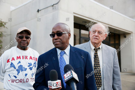 Stock Picture of Pastor-Adultery Accusations, pastor Juan D. McFarland, Shiloh Missionary Baptist Church Members of the Shiloh Missionary Baptist Church, Nathan Williams, left, James Long, center, and Montgomery attorney, Julian McPhillips, right, speak to the press at the Montgomery County Courthouse, in Montgomery, Ala. McPhillips announced that he filed a lawsuit Tuesday against longtime pastor Juan D. McFarland. The church wants to remove McFarland after being accused of having sex with the congregation members while infected with AIDS