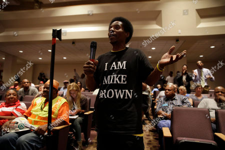 Larry Miller speaks during a public comments portion of a meeting of the Ferguson City Council, in Ferguson, Mo. The meeting is the first for the city council since the fatal shooting of Michael Brown by a city police officer
