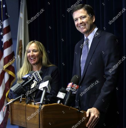 James B. Comey, Amanda Marshall FBI Director James B. Comey, right, is joined by U.S. Attorney Amanda Marshall during a news conference in Portland, Ore., . Comey spoke after the sentencing in federal court of Mohamed Mohamud, who was convicted last year of a terrorism charge