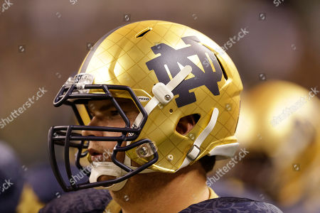 A logo is shown on the helmet of Notre Dame offensive linesman Sam Bush during the first half of an NCAA college football game against Purdue in Indianapolis
