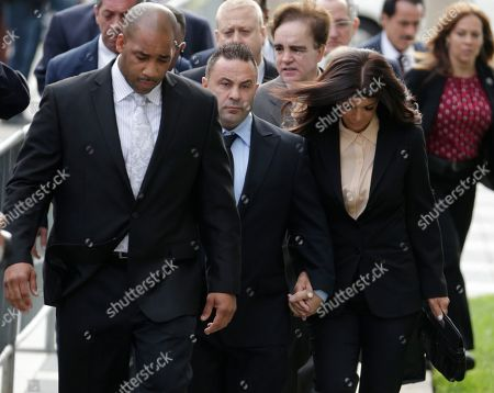 """Giuseppe """"Joe"""" Giudice, Teresa Giudice The Real Housewives of New Jersey"""" stars Giuseppe """"Joe"""" Giudice, 43, center, and his wife, Teresa Giudice, 41, right, of Montville Township, N.J., walk toward Martin Luther King, Jr. Courthouse before a court appearance, in Newark, N.J. The Giudices are scheduled to be sentenced on federal conspiracy and bankruptcy fraud charges"""