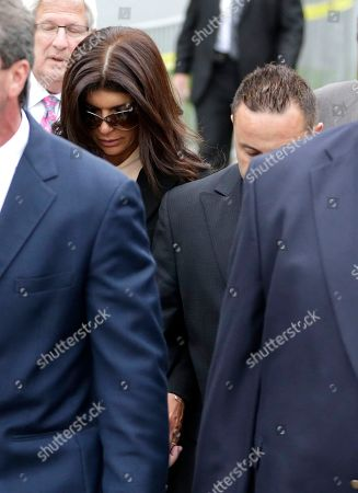 """Giuseppe """"Joe"""" Giudice, Teresa Giudice The Real Housewives of New Jersey"""" stars Teresa Giudice, 41, and her husband Giuseppe """"Joe"""" Giudice, 43, right, partially obscured, walk out of Martin Luther King, Jr. Courthouse after an appearance, in Newark, N.J. Teresa Giudice was sentenced Thursday in federal court to 15 months in prison on conspiracy and bankruptcy charges while her husband, Giuseppe """"Joe"""" Giudice, was sentenced to 41 months. Together they must pay $414,000 in restitution"""
