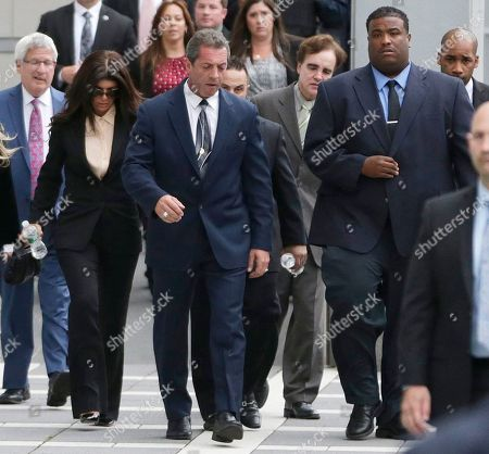 """Giuseppe """"Joe"""" Giudice, Teresa Giudice The Real Housewives of New Jersey"""" stars Teresa Giudice, 41, left, and her husband Giuseppe """"Joe"""" Giudice, 43, center left, walk out of Martin Luther King, Jr. Courthouse after an appearance, in Newark, N.J. Teresa Giudice was sentenced Thursday in federal court to 15 months in prison on conspiracy and bankruptcy charges while her husband, Giuseppe """"Joe"""" Giudice, was sentenced to 41 months. Together they must pay $414,000 in restitution"""