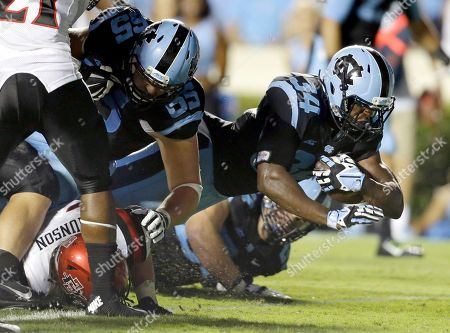 Stock Photo of Elijah Hood, Jared Cohen North Carolina's Elijah Hood (34) scores a touchdown against San Diego State as Jared Cohen (65) blocks during the second half of an NCAA college football game in Chapel Hill, N.C., . North Carolina won 31-27