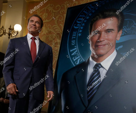 Arnold Schwarzenegger Former Gov. Arnold Schwarzenegger poses with his official portrait after it was unveiled at the Capitol in Sacramento, Calif., . The photograph-like giant image of the former governor was done by Austrian artist Gottfried Helnwein and will hang on the third floor of the Capitol