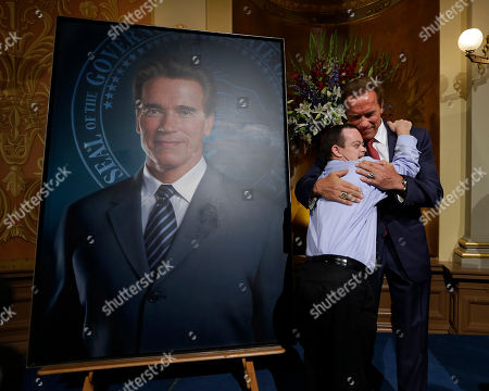 Arnold Schwarzenegger Former Gov. Arnold Schwarzenegger gets a hug from John Masterson, 28, who has Down syndrome, after he unveiled his official portrait at the Capitol in Sacramento, Calif., . The photograph-like giant image of the Republican governor was made by Austrian artist Gottfried Helnwein and will hang on the third floor of the Capitol. Masterson worked in the mail room when Schwarzenegger's was in office and continues to work there today