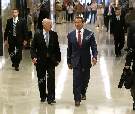 Jerery Brown, Arnold Schwarzenegger Gov. Jerry Brown, left, and former Gov. Arnold Schwarzenegger, walk to the rotunda of the Capitol where Schwarzenegger unveiled his official portrait, in Sacramento, Calif., . The painting of the former governor was done by Austrian artist Gottfried Helnwein and will hang on the third floor of the Capitol