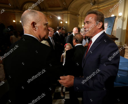 Jerry Brown, Arnold Schwarzenegger Former Gov. Arnold Schwarzenegger, right, talks with Gov. Jerry Brown, after Schwarzenegger unveiled his official portrait, at the Capitol in Sacramento, Calif., . The painting of the Republican governor was done by Austrian artist Gottfried Helnwein and will hang on the third floor of the Capitol