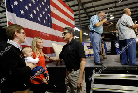 Rick Perry Texas Gov. Rick Perry speaks with Ryan and Betsy Minto and their child John Wesley Minto during a conservative rally in Smithfield, N.C