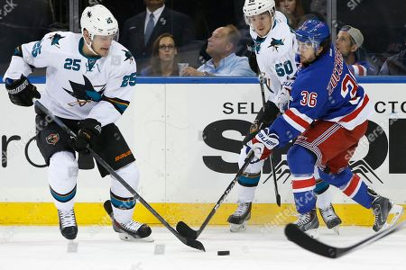 Tuye McGinn, Chris Tierney, Mats Zuccarello San Jose Sharks left wing Tye McGinn (25) and center Chris Tierney (50) go after a loose puck with New York Rangers right wing Mats Zuccarello (36), of Norway, defending during the first period of an NHL hockey game at Madison Square Garden in New York