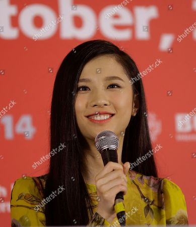 """Stock Image of Zhang Huiwen Chinese actress Zhang Huiwen speaks during a press conference to promote her movie """"Coming Home"""" at the Busan International Film Festival in Busan, South Korea"""