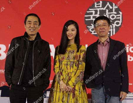 """Stock Photo of Zhang Huiwen, Zhang Yimou, Zhang Zhao Director Zhang Yimou, left, actress Zhang Huiwen and producer Zhang Zhao stand together during a press conference to promote their Chinese movie """"Coming Home"""" at the Busan International Film Festival in Busan, South Korea"""