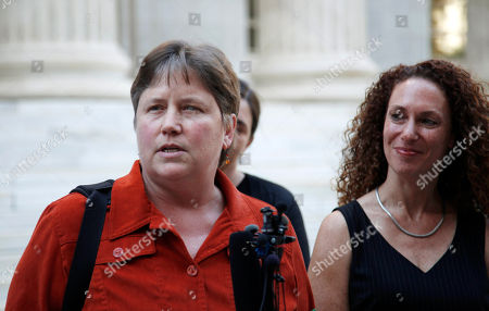 Kate Burns, Mari Newman Kate Burns, left, one of the plaintiffs who challenged Colorado's 2006 voter-approved gay marriage ban, responds to questions during a news conference in Denver as attorney Mari Newman looks on after the U.S. Supreme court declined to hear appeals from several states seeking to ban same-sex marriage on