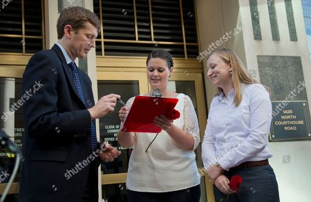 Paul Ferguson, Jennifer Melsop, Erika Turner Clerk of the Circuit Court of Virginia Paul Ferguson, left, watches Jennifer Melsop, 26, center, and Erika Turner, 26, sign their marriage license in front of the Arlington County Courthouse in Arlington, Va., . The Supreme Court cleared the way Monday for an immediate expansion of same-sex marriage by unexpectedly and tersely turning away appeals from five states seeking to prohibit gay and lesbian unions. The court's order effectively makes gay marriage legal in 30 states