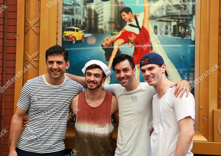 """Stock Photo of Ricky Ubeda, second from left, poses with Tony Yazbeck, left, Clyde Alves, second from right, and Jay Armstrong Johnson, the three stars of the Broadway musical """"On the Town"""" outside the Lyric Theatre in New York on . Ubeda, 18, from Miami, won Season 11 of """"So You Think You Can Dance"""" and one of the prizes was an ensemble role in the show"""