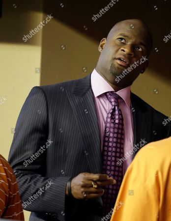 Vince Young Former Texas quarterback Vince Young visits with others in a side line suite during the second half of an NCAA college football game between Texas and UCLA, in Arlington, Texas