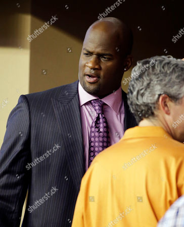 Vince Young Former Texas quarterback Vince Young visits with others in a sideline suite during the second half of an NCAA college football game between Texas and UCLA, in Arlington, Texas