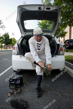 Stock Image of Vintage baseball player Dan Jurgens with the Resolute Base Ball Club of Elizabeth N.J. puts on his cleats ahead of the 2014 Base-Ball Exhibition & Fair at the Navy Yard in Philadelphia. The Mid-Atlantic league, which includes about 20 squads from Rhode Island to Virginia, plays by what are called the 1864 rules