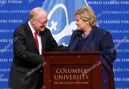 Norway Prime Minister Erna Solberg, right, is greeted by Columbia University Provost and professor John Coatsworth before speaking during the World Leaders Forum, at Columbia University in New York. Solberg addressed the need for peace to help end world poverty