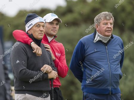 Martin Kaymer with arms round his father Horst Kaymer & Johann Rupert (r) on the 1st tee at Kingsbarns Golf Links during day 2 of The Alfred Dunhill Links Championship, Scotland on 6th October