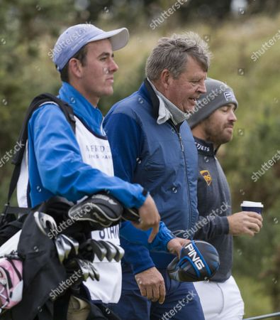 Johann Rupert & Louis Oosthuizen on the 1st hole at Kingsbarns Golf Links during day 2 of The Alfred Dunhill Links Championship, Scotland on 6th October
