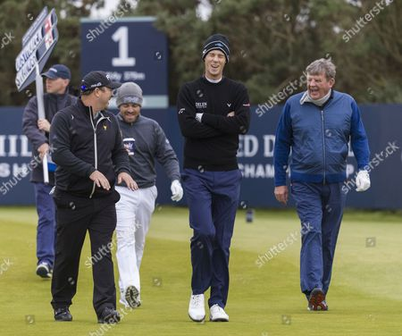 Stock Picture of Wynand Stander, Louis Oosthuizen, Johann Rupert & Thomas Pieters share a joke on the 1st tee at Kingsbarns Golf Links during day 2 of The Alfred Dunhill Links Championship, Scotland on 7th October