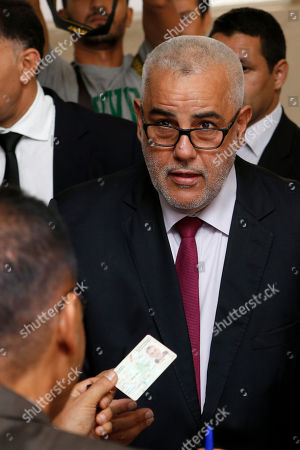 Prime Minister and leader of the Islamist Justice and Development Party, known as the PJD, Abdelilah Benkirane leaves after casting his ballot at a polling station for the parliamentary elections, in Rabat, Morocco, . Millions of Moroccans hit the voting booths, with worries about joblessness and extremism on many minds as they choose which party will lead their next government